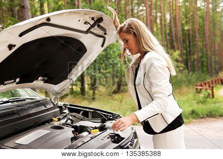Woman opened the hood broken car