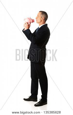 Businessman with piggybank