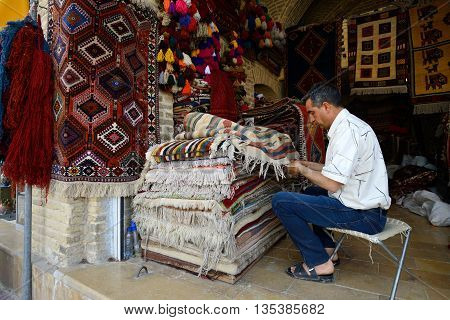 SHIRAZ - APRIL 14: Traditional iranian carpets in a market (Vakil Bazaar) in Shiraz Iran on April 14 2015. Vakil Bazaar is the most important tourist attraction in Shiraz Iran.