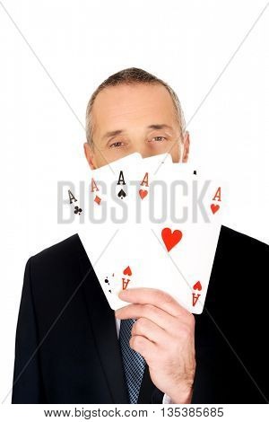 Elegant man with four aces
