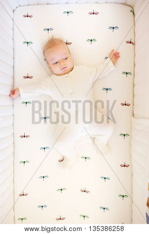 Four months old baby in bed