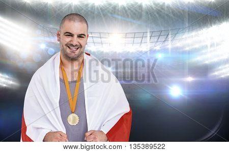 Athlete with olympic gold medal against american football arena