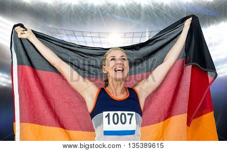 Athlete posing with german flag after victory against american football arena