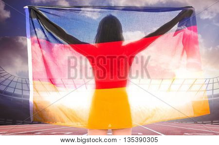 Athlete posing with german flag after victory against race track