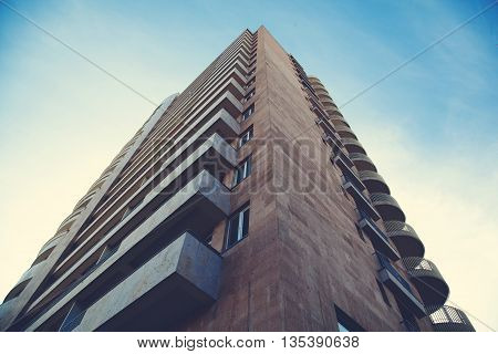 high building in sky with clouds background