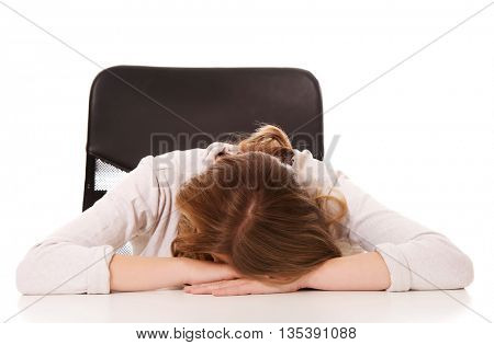 Young worried woman sleeping at the desk