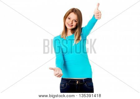 Woman showing thumbs up with both hands