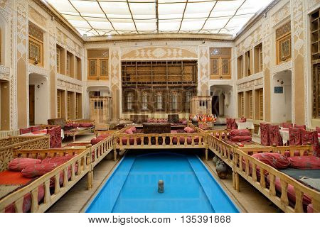YAZD - APRIL 17: interior of Malek-o-Tojjar hotel in Yazd Iran on April 17 2015. Malek-o-Tojjar as the first mud brick hotel world wide was inaugurated in 1997 and became complete with 23 rooms.