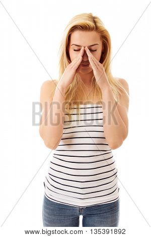 Woman covering her mouth, isolated on white.