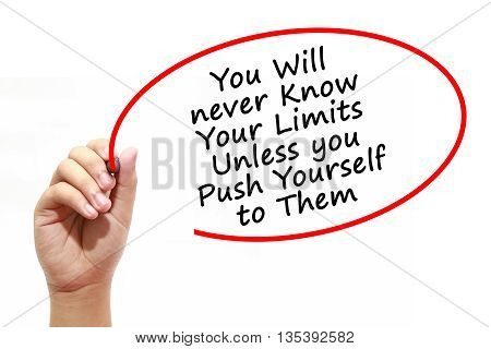 Man Hand writing You Will never Know Your Limits Unless you Push Yourself to Them with marker on transparent wipe board. Isolated on white. Business, internet, technology concept.