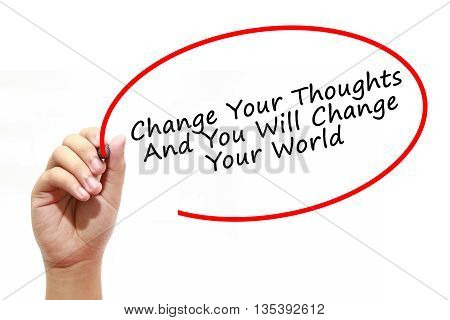 Man Hand writing Change Your Thoughts And You Will Change Your World with marker on transparent wipe board. Business, internet, technology concept.