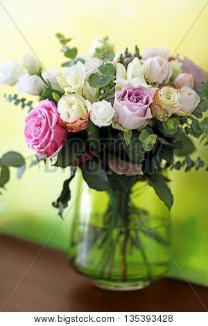 Vase with fresh roses, closeup