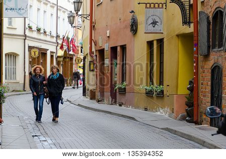 VILNIUS LITHUANIA - JULY 10 2015: Unidentified people walk along Stikliu Street in Old Town Vilnius Lithuania
