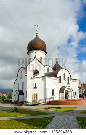 KLAIPEDA LITHUANIA - JULY 11 2015: Unidentified people visit Church in honor of Intercession of Mother of God and in the name of Saint Nicholas (Pokrovo Nicholas Church) Klaipeda Lithuania