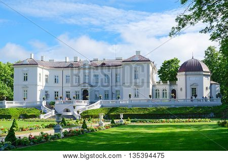 PALANGA LITHUANIA - JULY 12 2015: Unidentified people are relaxing near Amber Museum in Botanical Park in popular resort town of Palanga Lithuania