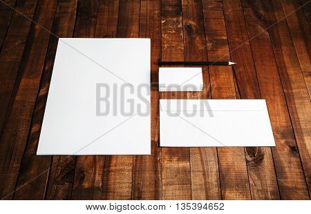 Blank stationery set on wooden table background. ID template. Mockup for branding identity for designers.
