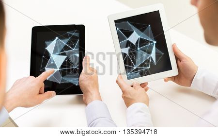 science, cyberspace, people and 3d technology concept - close up of businessman hands with low poly structure on tablet pc computer screens at office