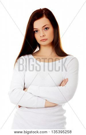 Annoyed young woman with arms crossed