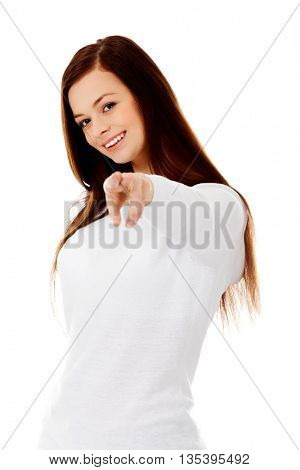 Young smiling woman pointing at the camera