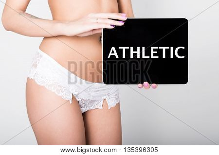 technology, internet and networking - close-up ass of girl in lacy lingerie, holding a tablet pc with athletic sign. Adult content.