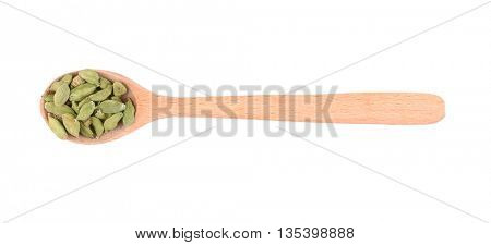 Cardamom seeds in spoon on white background
