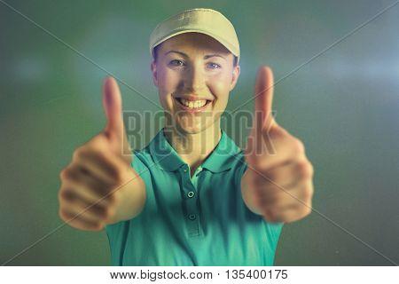 Sportswoman posing on black background against blue background
