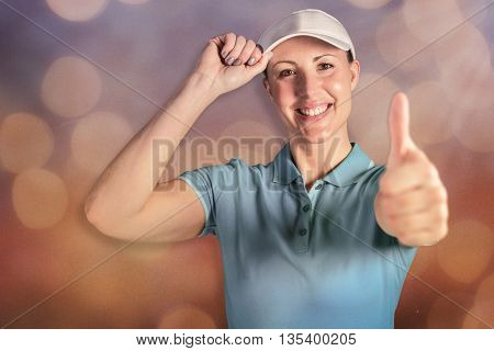 Sportswoman posing on black background against glowing background