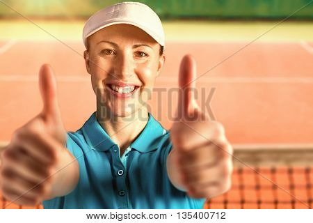 Sportswoman posing on black background against close up view of tennis court