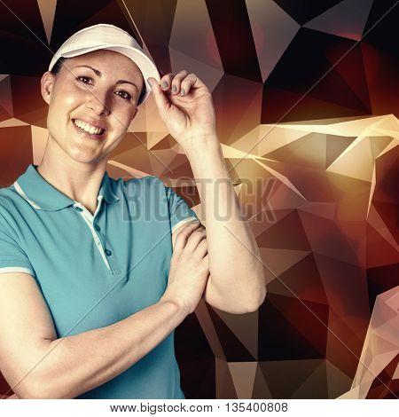 Sportswoman posing on black background against angular design