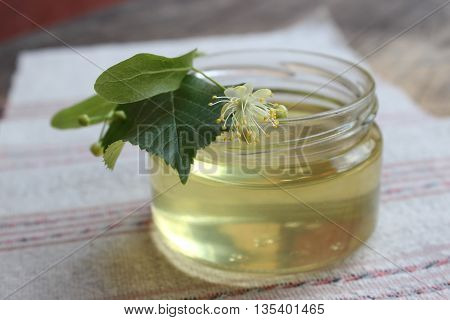 Linden flower and bee natural lime honey in a jar