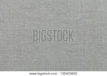 light gray background from a textile material. Fabric with natural texture. Cloth backdrop.