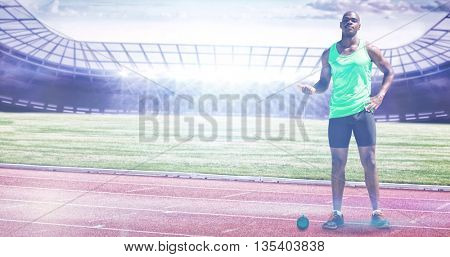 Man preparing to throw marter against race track