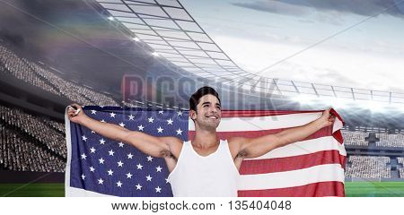 Athlete posing with american flag after victory against rugby stadium