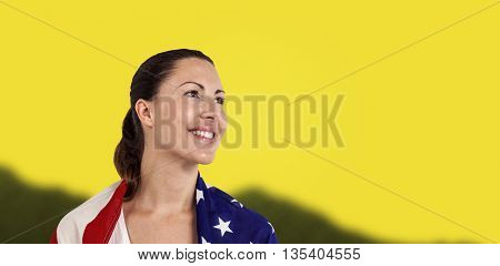 Athlete with american flag wrapped around his body against yellow background