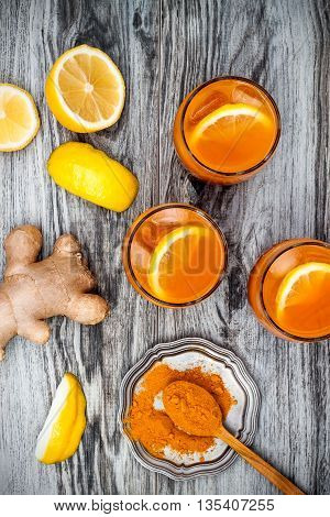 Carrot ginger immune boosting anti inflammatory lemonade with turmeric and honey. Detox morning juice drink clean eating