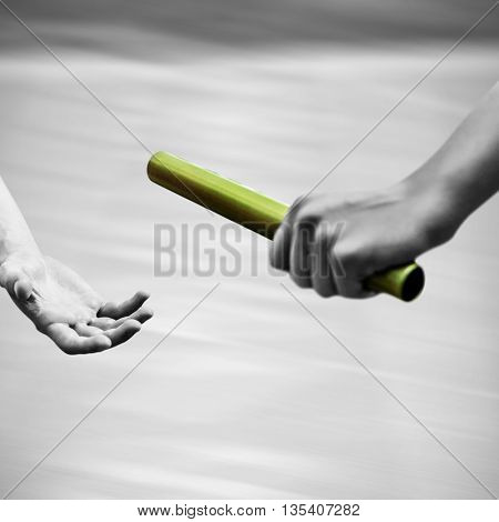 Athlete passing a baton to the partner with colored baton