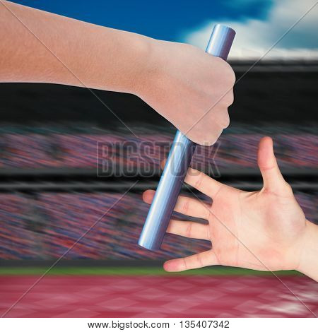 Close up of sportsman is holding a baton for a relay race
