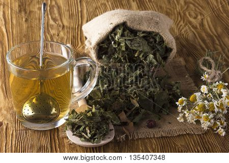 herbal tea with chamomile on a wooden table