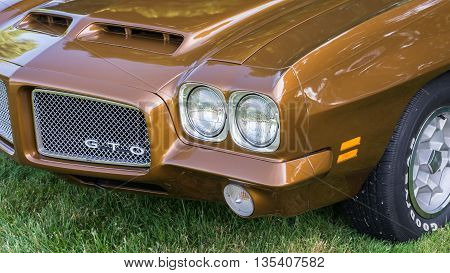 GROSSE POINTE SHORES MI/USA - JUNE 19 2016: A 1971 Pontiac GTO car at the EyesOn Design car show, held at the Edsel and Eleanor Ford House, near Detroit, Michigan.