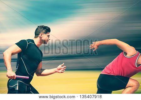 Confident male athlete running from starting blocks