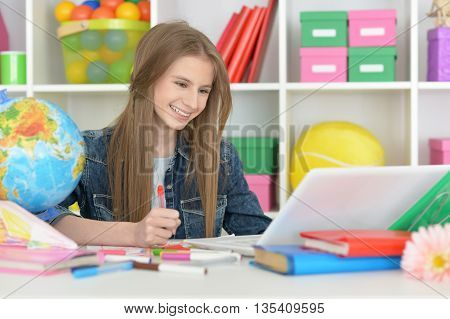 Cute  student girl at class with laptop