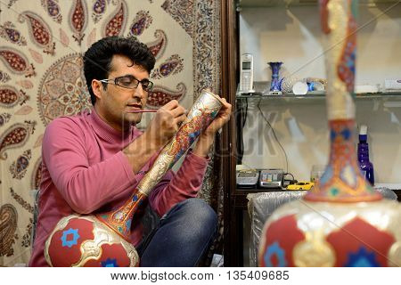 ISFAHAN - APRIL 19: Unknown man making traditional iranian vase in market (Bazaar) in Isfahan Iran on April 19 2015. Bazaar of Isfahan is the most important tourist attraction in Isfahan Iran.