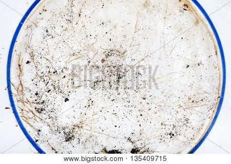 Muddy ceramic plate with blue linetexture background