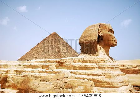 Sphinx Head and pyramid on Giza Egypt