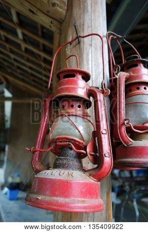 Antique kerosene lamp hanging on old wood