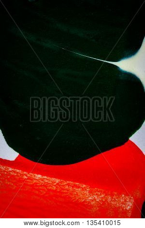 Closeup view of abstract hand painted black and red acrylic art background on paper texture