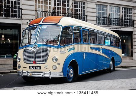 LONDON - OCTOBER 31: A vintage bus due to take part in a charity run to Brighton is stood on public display at the annual Regents Street classic car show on October 31, 2015 in London.
