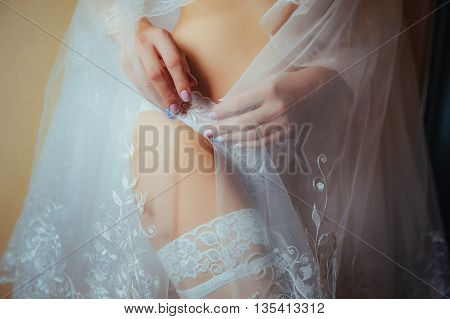 Sexy beautiful nude sexual bride with veil in white erotic lingerie