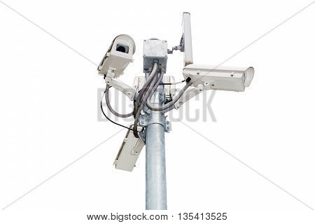 Group of security cameras (CCTV) or surveillance camera on pole isolated on white background.