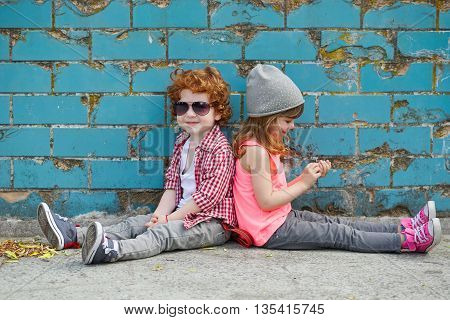 photo of two happy cute hipsters on the street